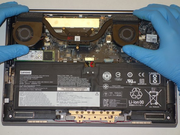 Gently lift the fan assembly out of the laptop.