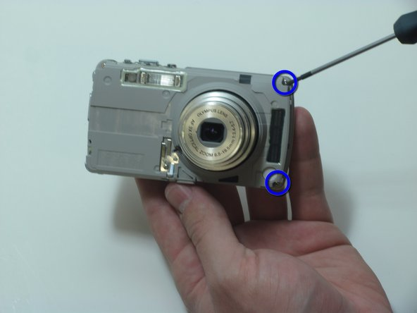 Remove the 2 screws on the right side of the camera.