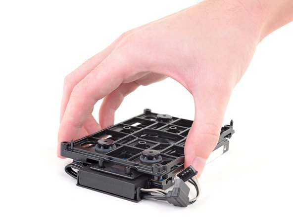 Lift the mounting bracket off the hard drive.