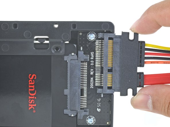 Plug the included sensor-enabled SATA cable into the enclosure's port.