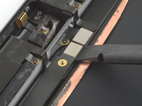 Use the flat end of a spudger to disconnect the headphone jack by lifting straight up on the press connector.