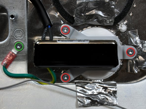 Remove the four T10 Torx screws securing the AC power inlet and its ground cable to the rear panel.