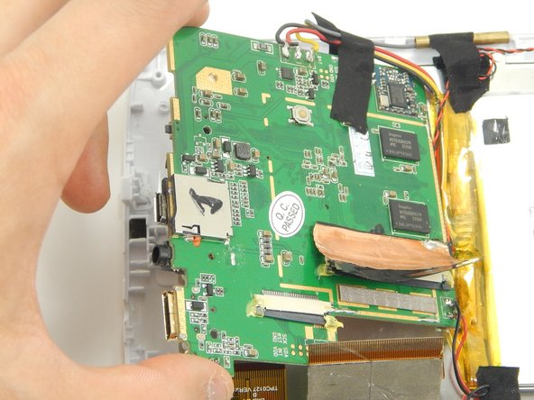 Gently lift up the motherboard and reorient it in a more efficient manner in order to locate the desired components.