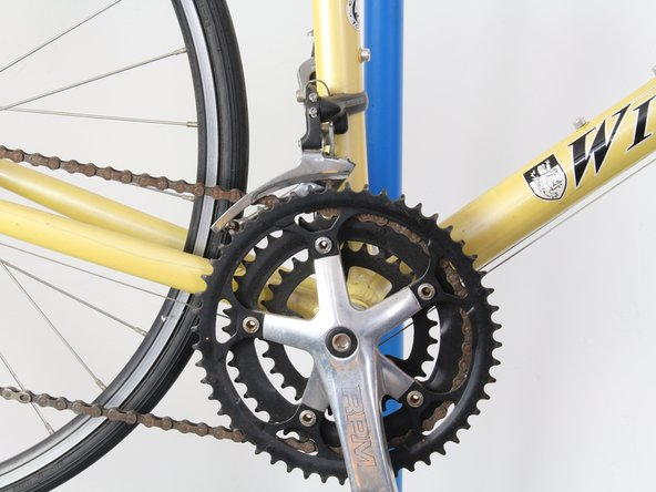 The chain connects the crank arm to the gear cluster on the back wheel.