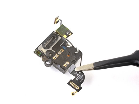 Use a pair of tweezers to peel away and remove the Soli motion sensor cable, which is held in place with some light adhesive, leaving just the earpiece speaker.