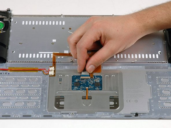 Slide the keyboard ribbon out of its connector.