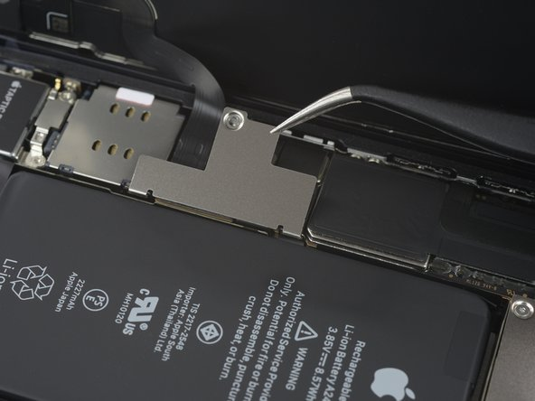 Use a pair of tweezers to remove the battery & display connector bracket.