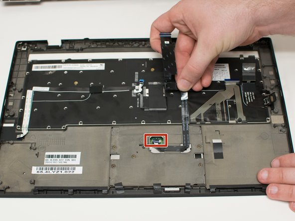 Lift the ribbon cable locking mechanism.