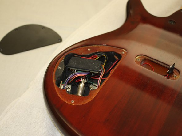 Remove cap by lifting upwards, revealing the circuitry of the instrument.