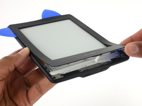Adhesive is holding the bezel in place.
