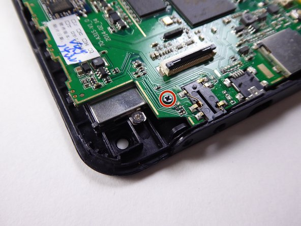 Use a Phillips #000 screwdriver to remove the 3.6mm screw.