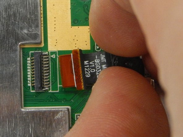 Gently by hand, remove the camera and its ribbon by pulling the camera away from the motherboard.