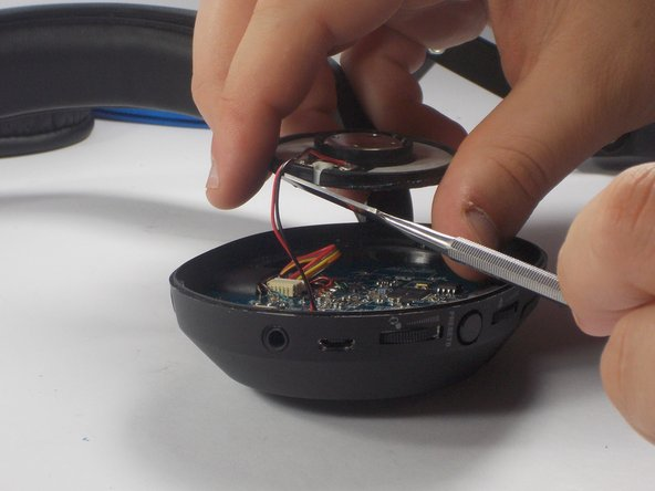 Using  wire cutters, cut the red and black wires connecting the speaker to  the circuit board. Be careful to leave at least one inch of wire to use reconnect wires to new speaker.