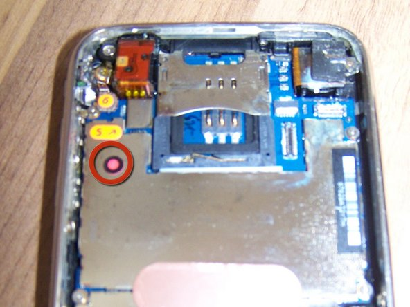 The water damage sticker is now pink, indicating that the inside of this phone was flooded with liquid.