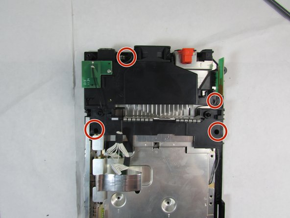 Remove the four black 10 mm screws attached to the black plastic frames using the Phillips #0 screwdriver.