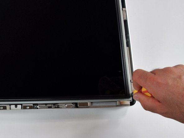 The LCD panel is held in place with eight T10 Torx screws.