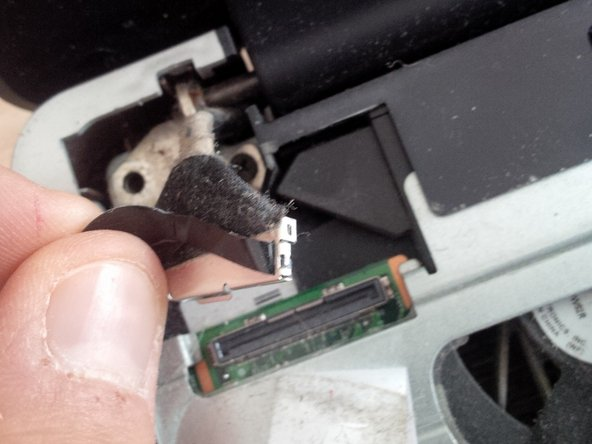 Remove the black flat wire of the LCD screen from the motherboard.