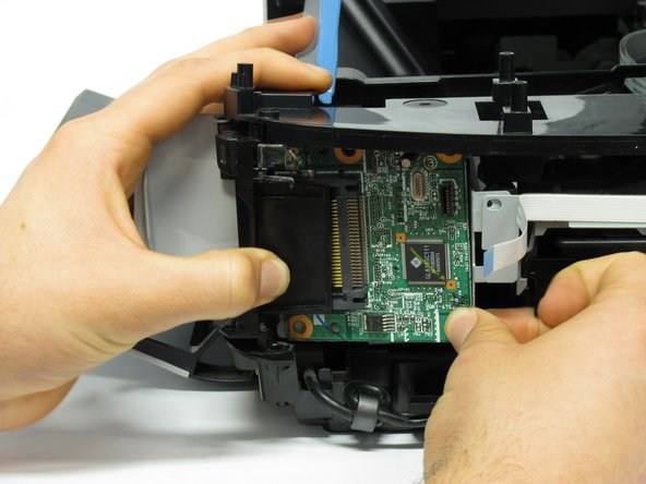 Completely remove the board from the printer by pulling the board towards the back of the printer.