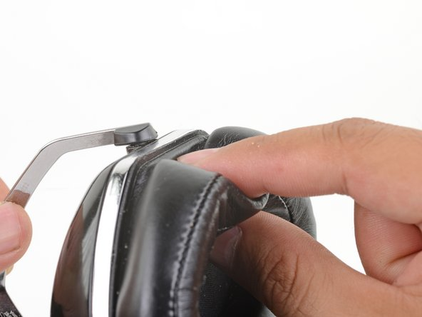 The battery is housed in the left half of the headphones (the side with the micro-USB port).