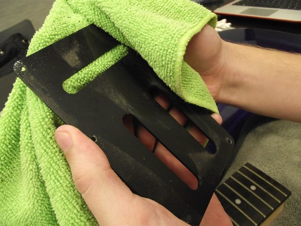 Use a microfiber cloth to clean dust off of plastic or wood components.