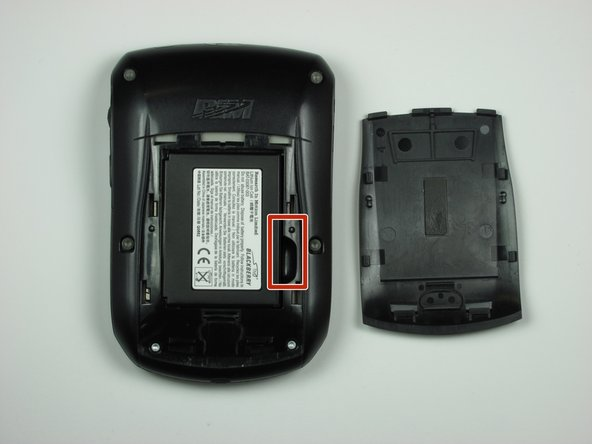 Locate groove along the right side of the battery compartment.