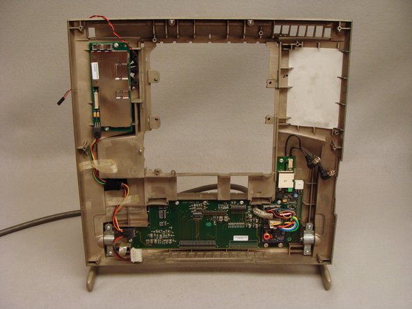 Lift the logic board from the left edge then straight up to remove it from the rear case.