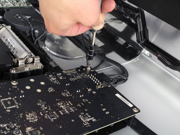 For the last wire connecting to the LCD, use your TR 10 Screwdriver to remove the screw.