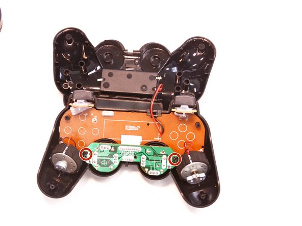 Remove the two 6.1 mm screws holding the internal analog stick board and the front of the controller together.