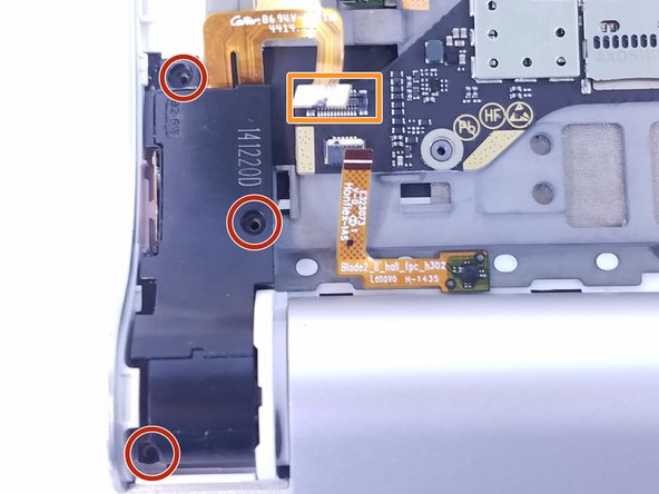 Remove the three 2mm screws on the back of the left speaker module with the Phillips Screwdriver #00 bit.