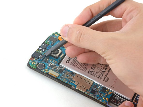 Use a spudger to disconnect the front facing camera from the motherboard.