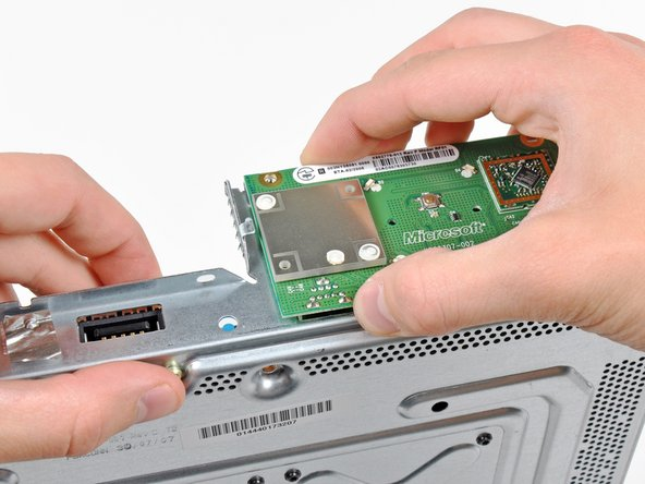 Grasp the RF module and lift it straight up to disconnect it from its socket on the motherboard.