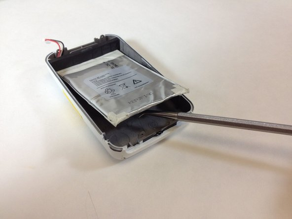 Use a plastic opening tool or nylon spudger to lift up the battery.