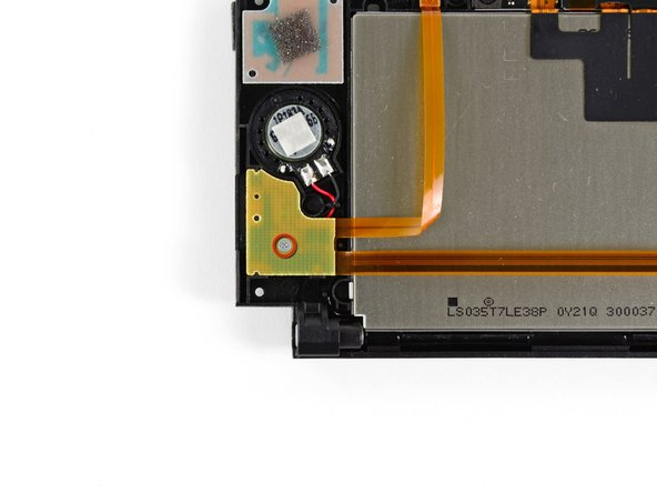 Remove the 2.5 mm Phillips screw securing the right speaker board to the upper display bezel.