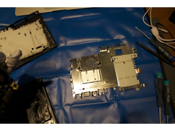 Flip the motherboard over and remove the five screws of the second metal casing.