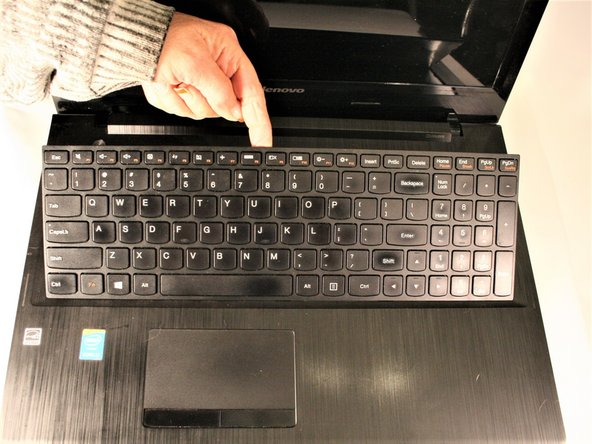 Once the top of keyboard is loose, gently lift up