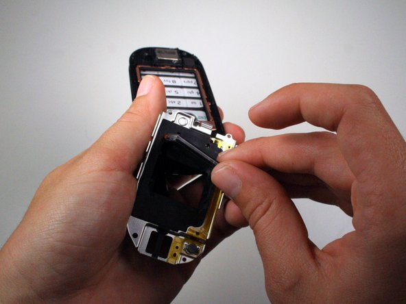 Using your fingers, remove the front display.