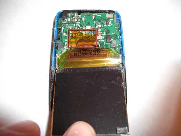 Pull back LCD to bottom of player to expose cable/clip