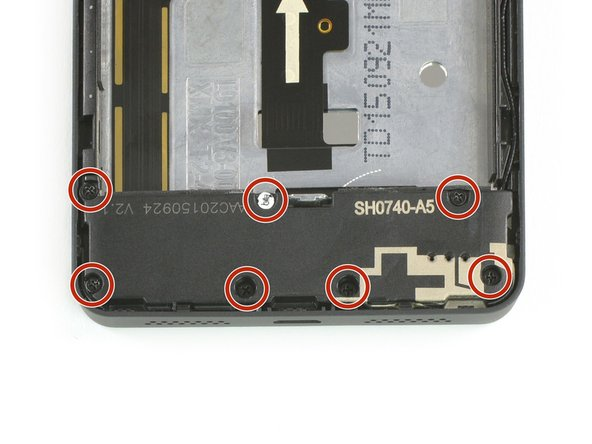 Take out the seven 4mm Phillips #00 screws, holding the loud speaker unit to the mid frame of the phone.