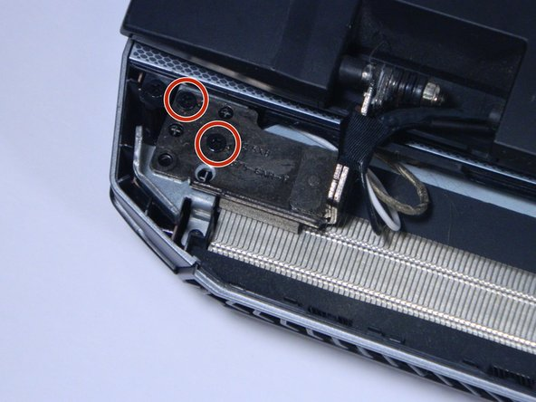 There will be two smaller and  two larger black screws on each hinge holding the laptop screen onto the computer. Remove all four of the larger screws with your P0 screwdriver.