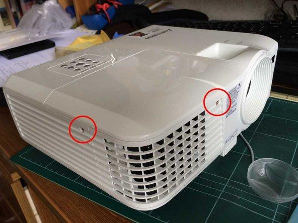 Remove 2 screws retaining the lamp cover.