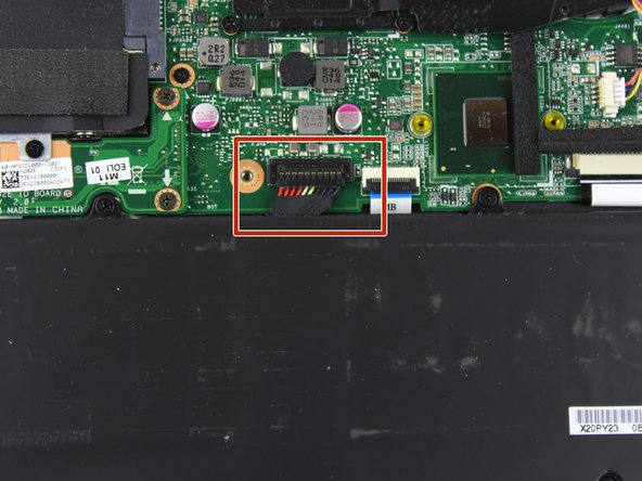 Remove the ribbon cable with a pair of tweezers.