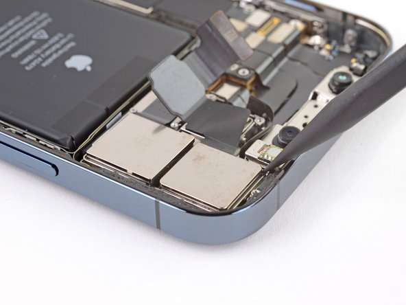 Use the tip of a spudger to lift the camera assembly out of the iPhone.