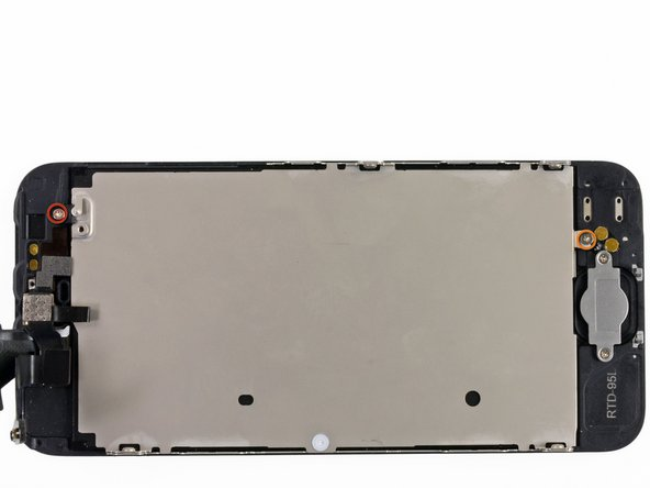 Remove the following two screws securing the LCD shield plate to the display assembly: