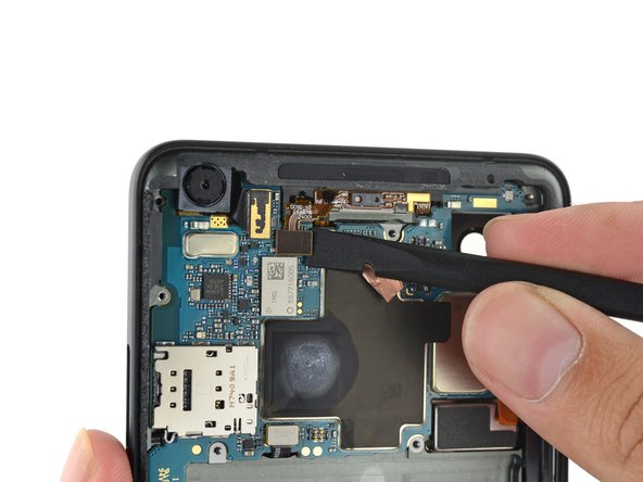 The front sensor array gets unplugged, but stays in the phone for now—we have bigger fish to fry.