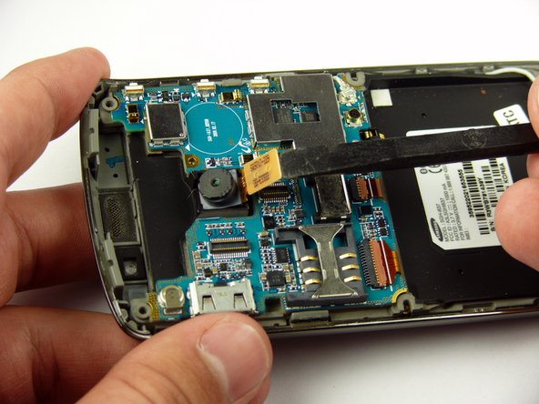 Use a spudger to detach the camera ribbon cable.