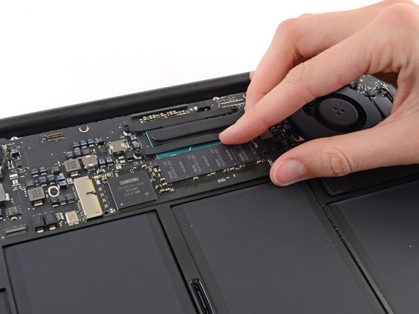 Gently lift the end of the SSD about half an inch and pull it straight out of its socket on the logic board.