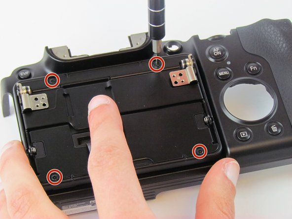 Use the Phillips #00 screwdriver to remove the four black 2.3 mm screws.