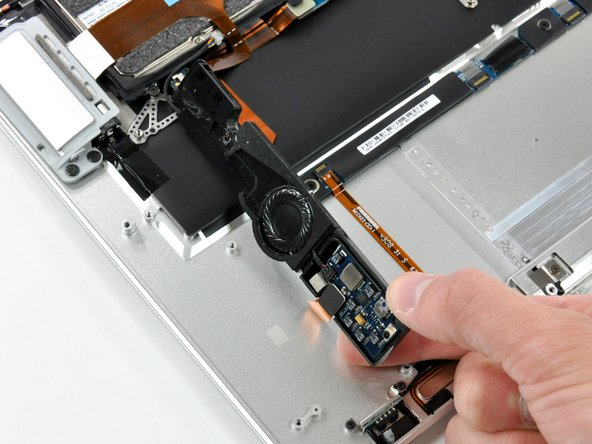 Rotate the speaker assembly toward the center of the Air.