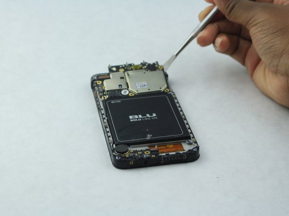 Use the spudger to gently lift the motherboard out of the device.