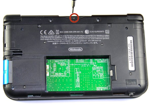 Remove the 2.3 mm screw located above the game cartridge slot with a Phillips #000 screwdriver.